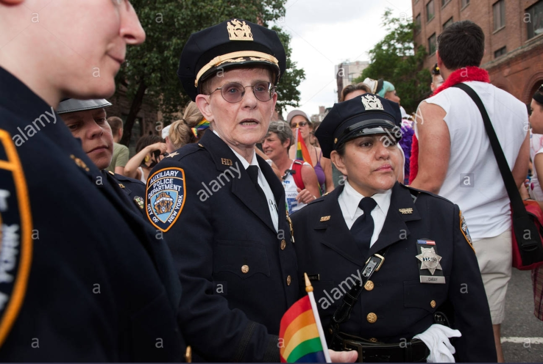 gay-female-police-officers-stand-together-at-the-gay-pride-parade-C5GYPW